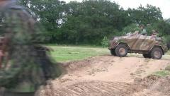 German troops and armored car attack on the battlefield - stock footage