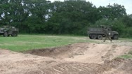 Stock Video Footage of German soldiers advance past abandoned US Military vehicles