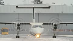 Small commuter passenger airplane taxing from defrost area - stock footage