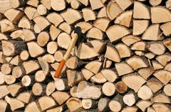 stack of woods and axe - stock photo
