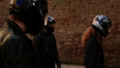 Masked men walk into frame Stock Footage