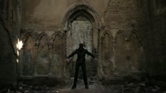 Masked woman chained in old church ruins Stock Footage