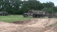 US Army Half Track advances on the battlefield Stock Footage