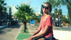 Portrait of young woman with laptop computer in the park, steadycam shot Stock Footage