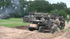 US Troops fight on the battlefield during a WWII re-enactment - stock footage