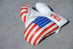 Boxing gloves against gray background Stock Photos