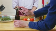 Stock Video Footage of Opening a beer bottle