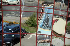 distorted reflection of cars and buildings - stock photo