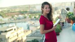 Stock Video Footage of Portrait of smiling woman with tablet standing on the terrace, crane shot