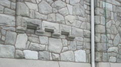 Tilt up to church window old stone church Stock Footage