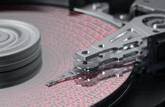 Symbolic hard disk and data detail Stock Photos