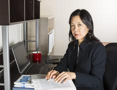 professional mature woman income tax accountant at work - stock photo