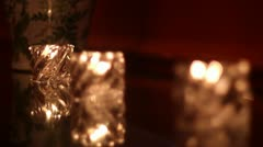 rack focus glass candles in a row - stock footage