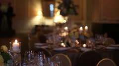 Pan left table set for fancy dinner Stock Footage