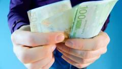 Man takes out euro money from his pocket and counted it Stock Footage