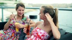 Female friends drinking beverages in restaurant by the sea, steadicam Stock Footage