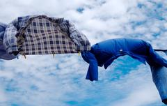 drying line shirts on wind with copy space on sky  background - stock photo