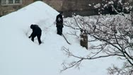 Men removing snow from the roofs Stock Footage
