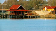 Stock Video Footage of Stilts houses on the water