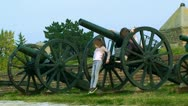 Stock Video Footage of Old military artillery and children