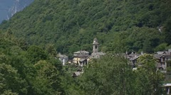 Castasegna Village on mountain slope between chestnut trees Stock Footage