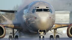 Close up of airplane at deice platform Stock Footage