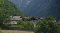 Tile roofed chalets on mountain slope, Soglio, Switzerland Stock Footage