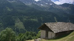 Stone-tiled roof of chalet in Swiss mountain valley. Stock Footage