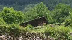 Chalet on mountain slope Stock Footage