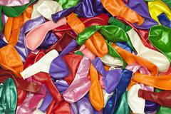 Different colored balloons stacked in pile Stock Photos