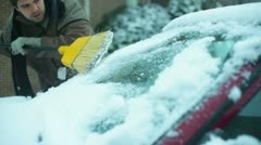 Cleaning snow car Stock Footage