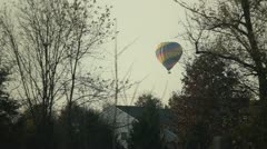 Hot air baloon flying over trees Stock Footage