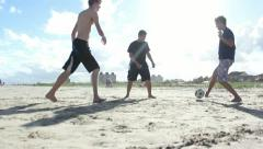 Boys playing soccer at the beach in Brazil. Stock Footage