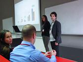 Young business people giving presentation. Stock Photos