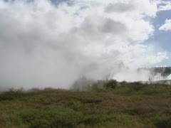 Volcanic activity: damp from crater in earth surface + pan Stock Footage