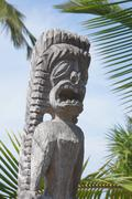 carved wooden statue of ancient hawaiian god.. - stock photo