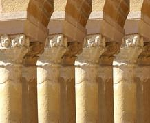 carved corinthian capitals from a medieval cloister .. - stock photo