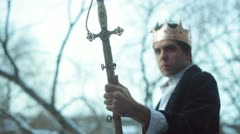 King with sword excalibur Stock Footage