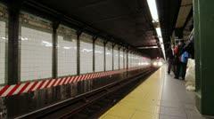 Train entering NYC subway stop Stock Footage