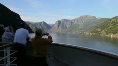 Norway tourists photographing Aurlandsfjord c Stock Footage