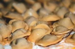 Uncooked ravioli pasta prepared and ready for cooking Stock Photos