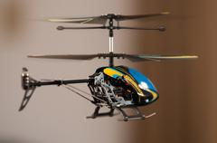 Flying rc helicopter Stock Photos