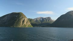 Norway mountains rise above Sognefjord c Stock Footage