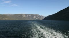 Norway a wake in Sognefjord with mountains beyond c - stock footage