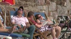 Deckchair Sunbathers Stock Footage