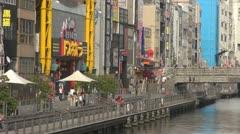 People visiting Dotonbori canal, Osaka, Japan Stock Footage
