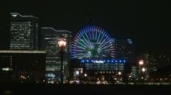 Cosmo Clock 21, Ferris wheel, at twilight, Yokohama, Japan Stock Footage