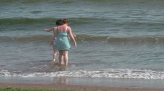 Wading In and Out of Sea Stock Footage
