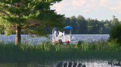 Family fishing from pontoon Stock Footage