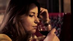 Sad young woman drinking wine in cafe, steadicam shot HD Stock Footage